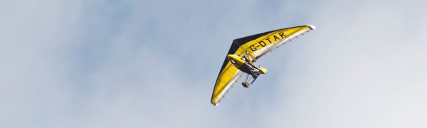 Flexwing microlight in the sky taken from the ground